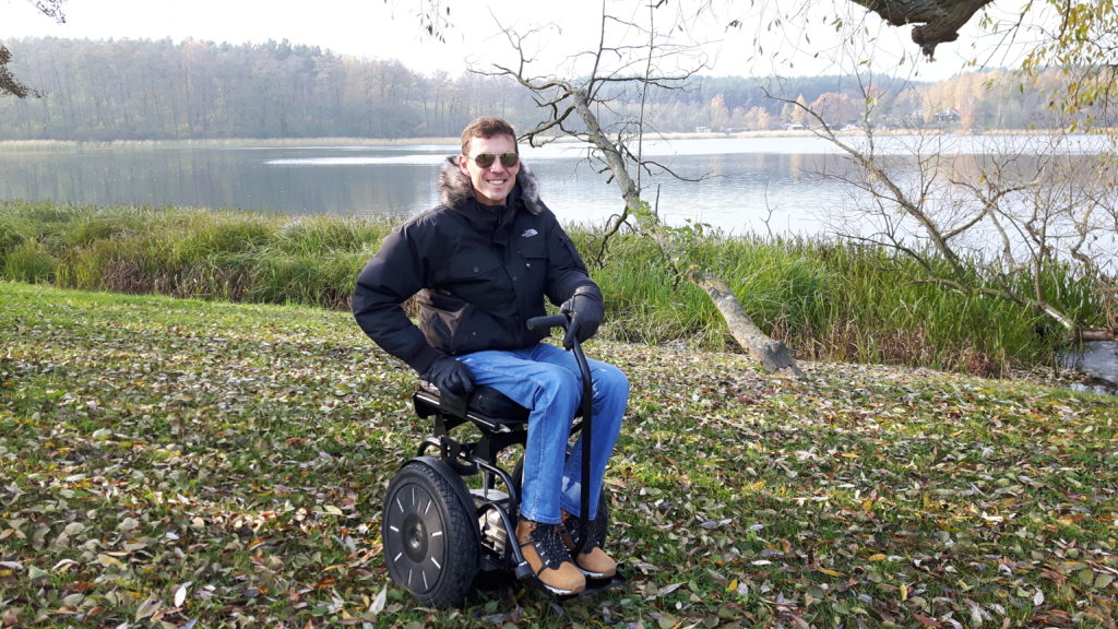 Blumil electric wheelchair by the lake