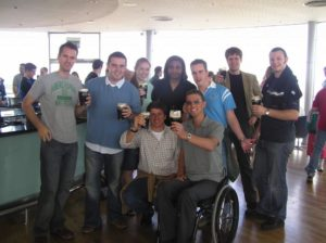 Beer enjoyed carefully on electric wheelchair