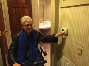 Operating an electric wheelchair in a hotel