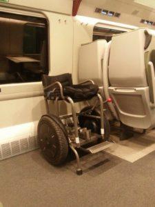 Blumil i2 electric wheelchair on a train
