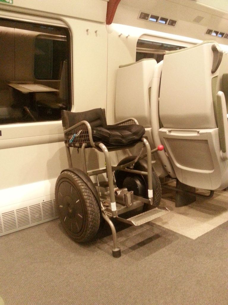 Blumil electric wheelchair in a train, public transport, accessible travel