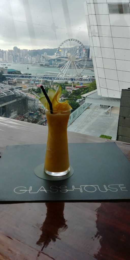 Drinking juice in Hong Kong, city view, accessible traveling, wheelchair friendly travel
