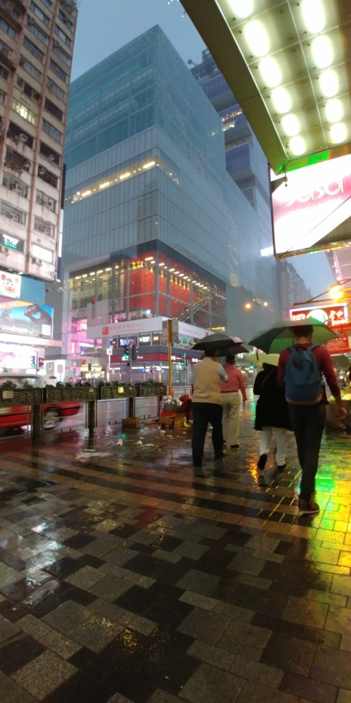 Rainy Hong Kong, umbrellas in the rain, accessible travel in Asia, wheelchair friendly travel, electric wheelchair