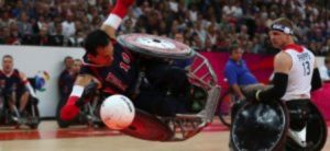 Players of electric wheelchair rugby